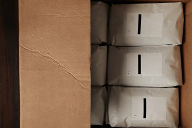 big carton box full of packages with coffee