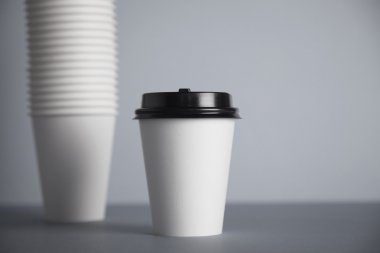 white paper cup with black cap