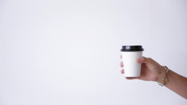 hand moves smoothly white paper cup