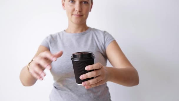 woman opens and close cap on paper cup