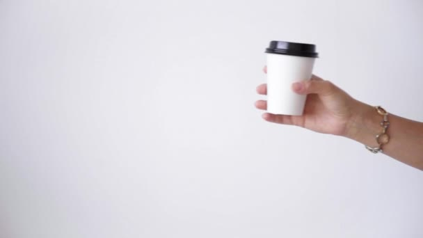 Woman hand gives white paper cup to man