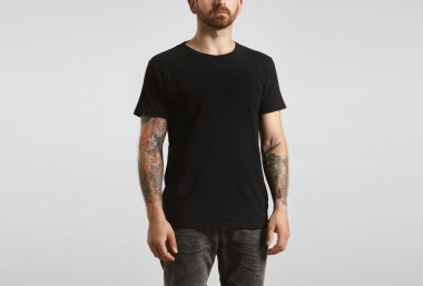 man poses in black blank t-shirt