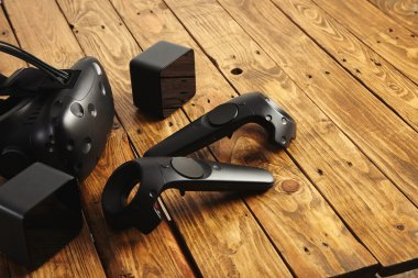 VR equipment set presented on wooden table