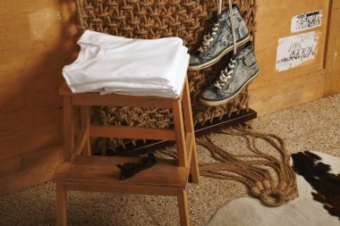 folded blank t-shirts  on chair