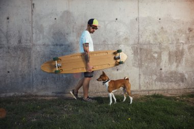 surfer looking down at dog