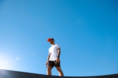 Hipster inskate park against blue sky