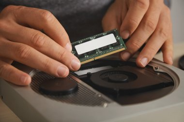hands removing memory plate