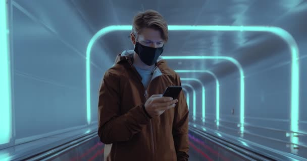 Young man travel in face mask in urban city space