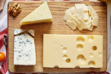 four cheeses closeup on wooden board