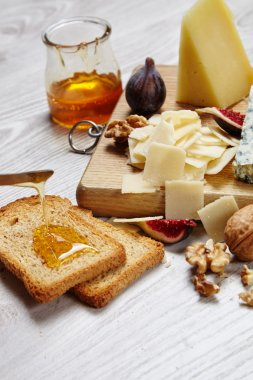 Close up four cheeses with supplements