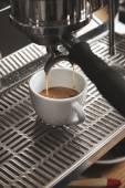 Preparing coffee on italian machine in cafe shop