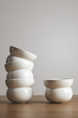 Mix of shaped ceramic coffee cups on table