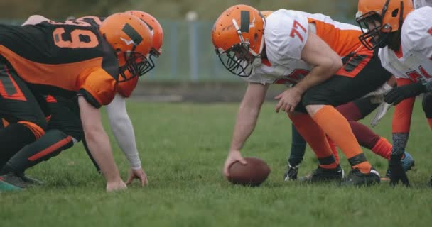 American football, football team in the game, training aggressive opposition during the game, 4k slow motion.