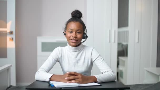 Distance learning and homeschooling online, african teen girl uses a videocall and webcam to studying during a pandemic, remote learning at school.