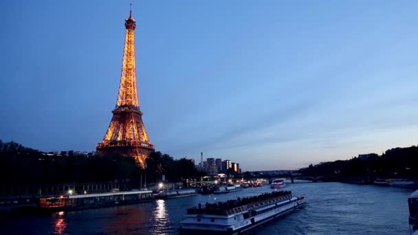 The Eiffel Tower in the evening from the river side in Paris