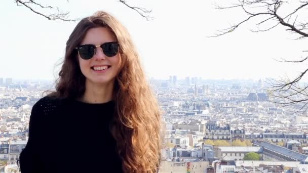 Smiling girl in a summer day in Paris