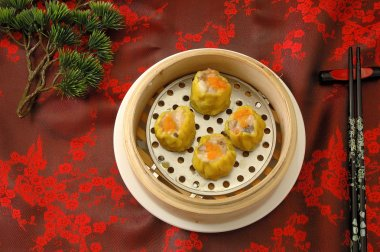 yumcha.   dim sum in bamboo steamer with chinese bun , pao , bao zi , steamed dumpling , shumai on table in chinese restaurant. chinese cuisine.Crab roe shao-mai