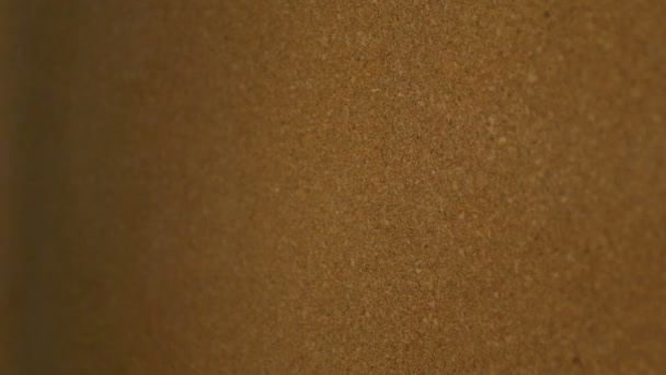 Pinning a paper on cork board