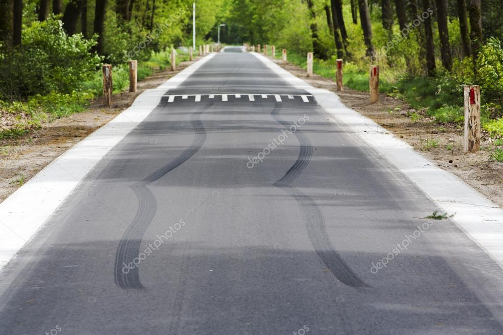 skid marks in front of speed bump stock photo kievith 84271062