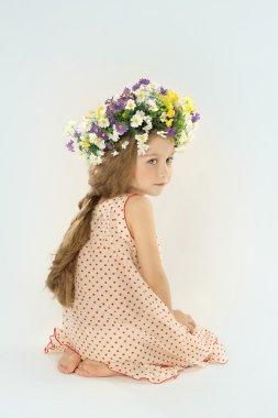beautiful little girl in  floral wreath