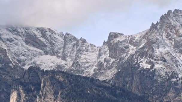 Panning the Grand Teton mountain range after snow storm capapping the mountains in Wyoming.