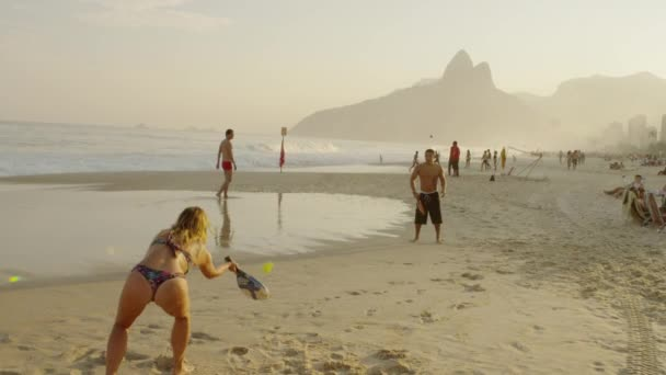 girl playing tennis on Ipanema beach