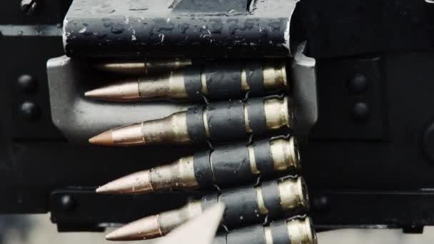 chain of bullets going through machine gun.