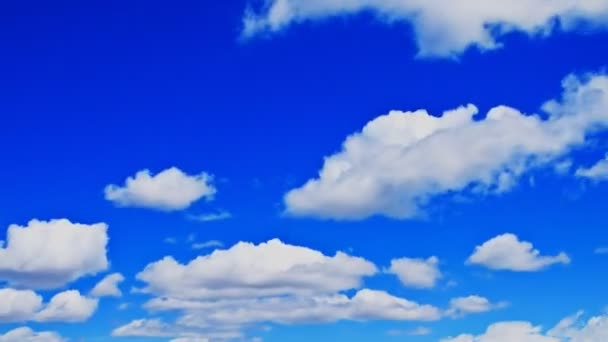 Billowing clouds in a deep blue sky.