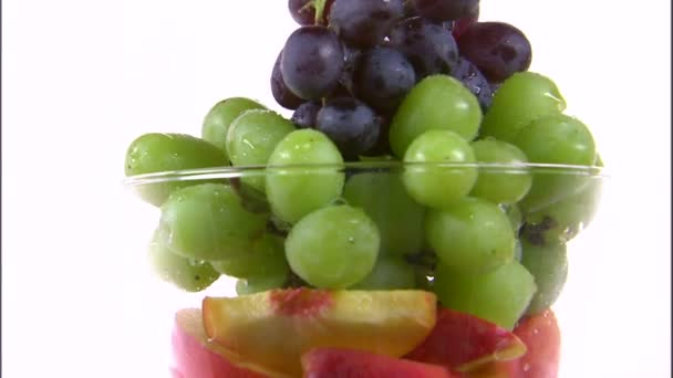 Assortment of fruit rotating in a vase