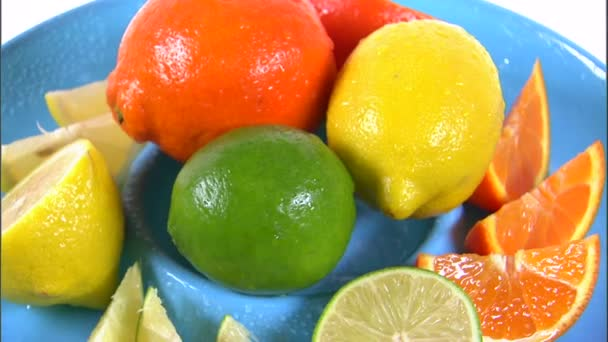 Assortment of citrus fruit rotating on a plate