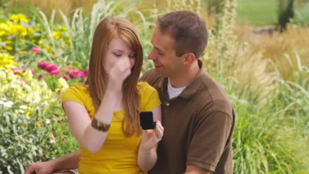Man proposes to a woman in garden