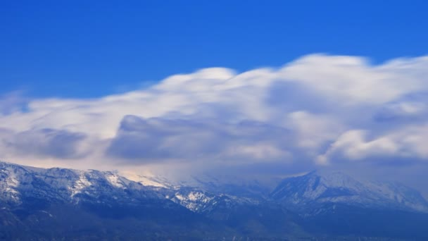 Time-lapse shot of snow-capped mountain peaks in Utah