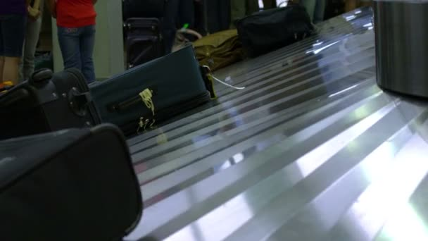 Luggage at the baggage claim at the SLC airport.