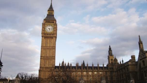 Tilt down Big Ben to busy street below in London.