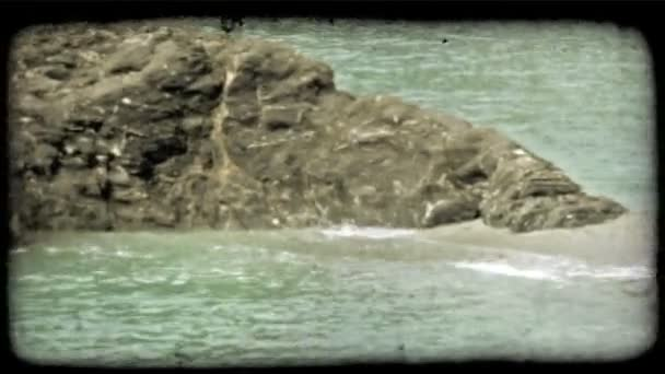 Rock in Ocean. Vintage stylized video clip.