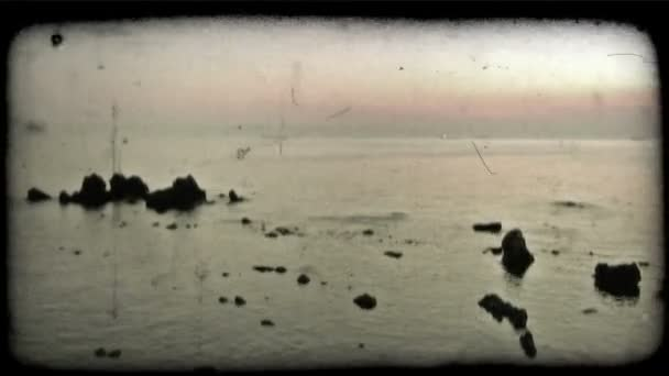 Ocean Sunset . Vintage stylized video clip.