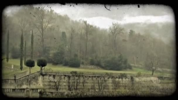 Foggy mountains. Vintage stylized video clip.