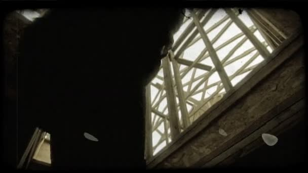 People ascend stairs in house frame. Vintage stylized video clip.