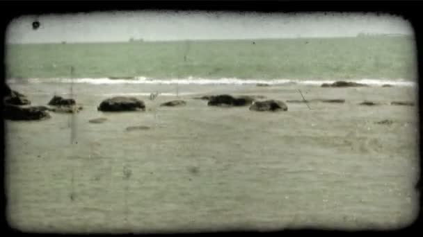 Waves on Rocks . Vintage stylized video clip.
