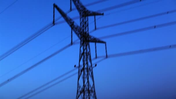 Stock Footage of an electrical transmission tower against a blue sky in Israel.