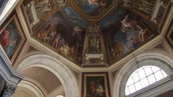 Tourists take photos of a ceiling fresco