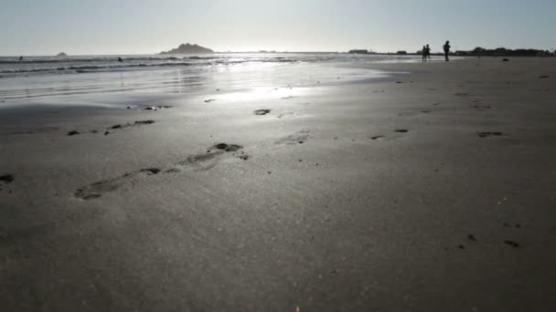 Three little girls running on beach