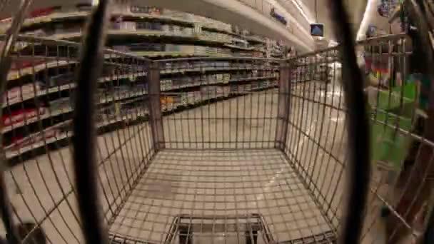 shopping cart moving down aisles