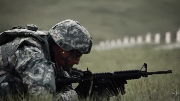 Soldiers shooting at targets from prone position