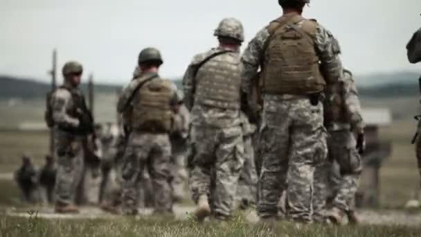 Soldiers walks across training field