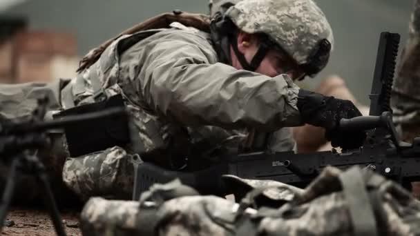 Soldier loads M240