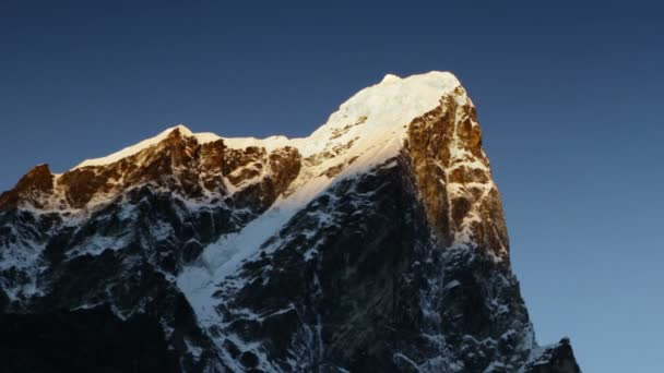 Panning shot of Time-lapse of the moon passing by Himalayan peaks
