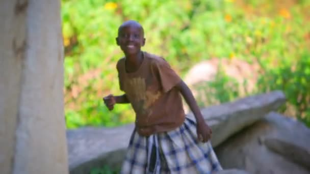 Little African boy dancing in the forest of Kenya
