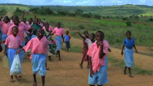 Little Children running alongside a car in Kenya.
