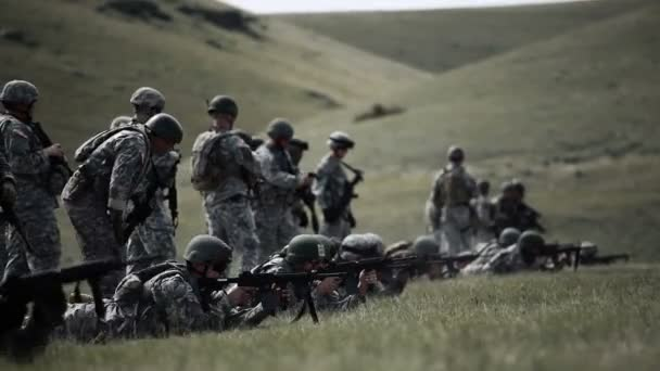 Soldiers practicing different shooting stances